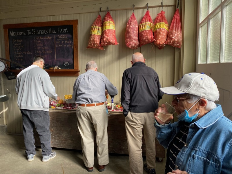 Jesuits at Sisters Hill Farm meal